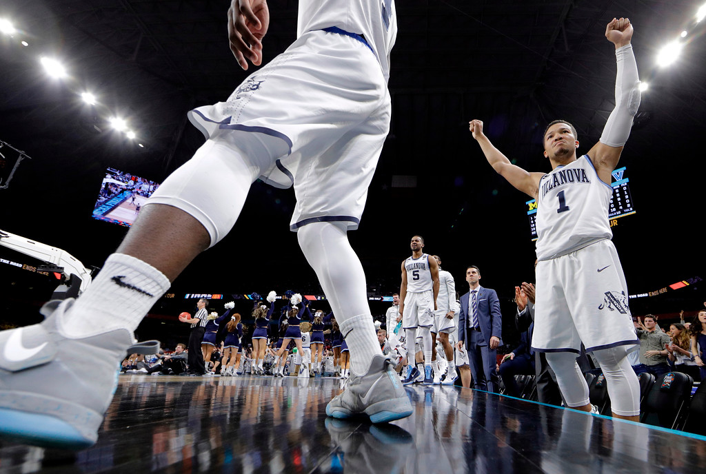 . Villanova\'s Jalen Brunson (1) and players on Villanova bench react during the second half in the championship game of the Final Four NCAA college basketball tournament against Michigan, Monday, April 2, 2018, in San Antonio. (AP Photo/David J. Phillip)