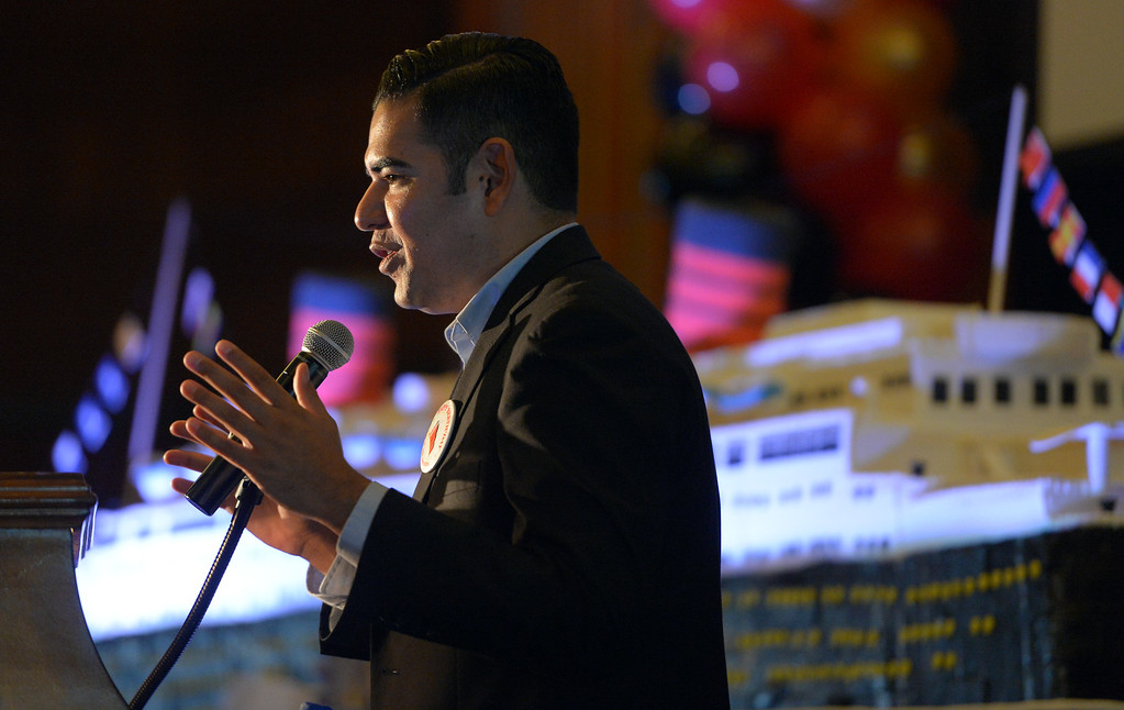 . Mayor Robert Garcia helps the Queen Mary celebrate its 80th anniversary of her launching in Long Beach, CA on Friday, September 26, 2014. After some speeches and a short film, guests were able to sample a slice of cake from a 15-foot long, 600-pound replica of the ship made by baker Jose Barajas. (Photo by Scott Varley, Daily Breeze)
