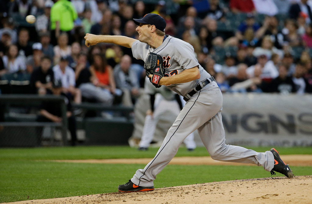 . Detroit Tigers starter Max Scherzer throws against the Chicago White Sox during the third inning of a baseball game in Chicago on Thursday, June 12, 2014. (AP Photo/Nam Y. Huh)