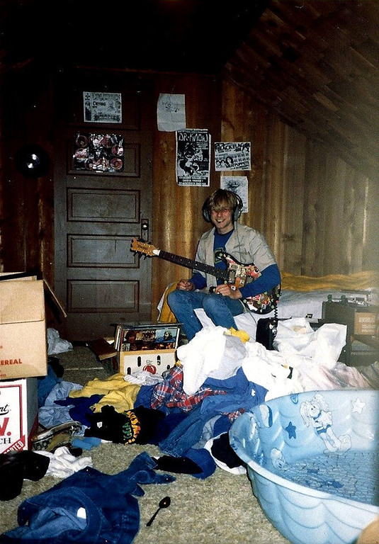 . In this undated photo provided by Kim Cobain, a young Kurt Cobain plays guitar in his childhood home in Aberdeen, Wash.  Cobain\'s mother, Wendy O\'Connor, is putting the 1.5-story Aberdeen bungalow _ which is assessed at less than $67,000 _ on the market for $500,000. But she\'d also be happy entering into a partnership with anyone who wants to turn it into a museum. (AP Photo/Courtesy Kim Cobain)