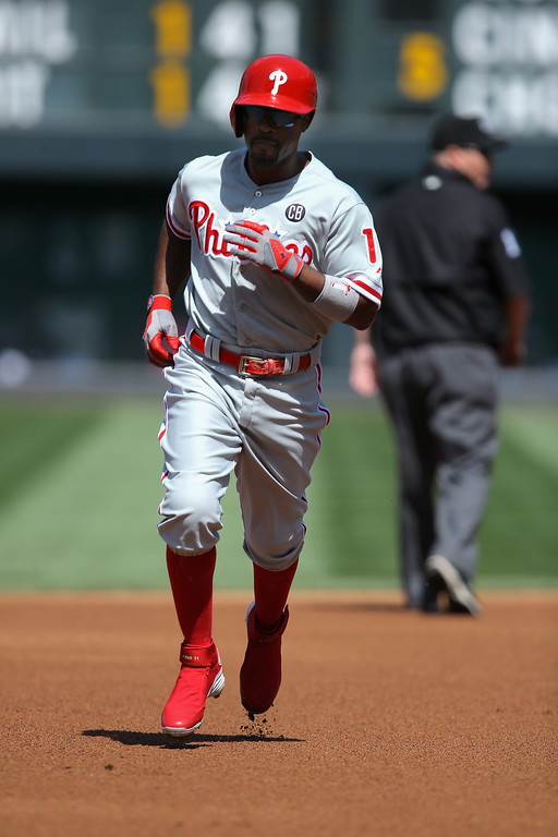 . Jimmy Rollins #11 of the Philadelphia Phillies rounds the bases on his solo home run off of starting pitcher Juan Nicasio #12 of the Colorado Rockies to take a 1-0 lead in the first inning at Coors Field on April 20, 2014 in Denver, Colorado.  (Photo by Doug Pensinger/Getty Images)