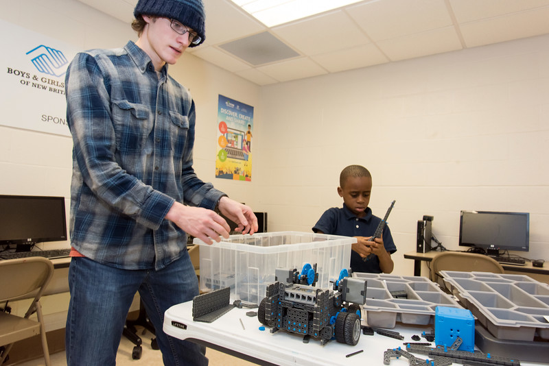 12/04/18  Wesley Bunnell | Staff  The Bristol Boys and Girls Club held robotics classes in collaboration with the New Britain Boys and Girls Clubs on Tuesday nights where Bristol employees taught students at the New Britain location. Bristol employee Nathan Benham helps six year old Terrance McKinnis break down his project at the end of class.