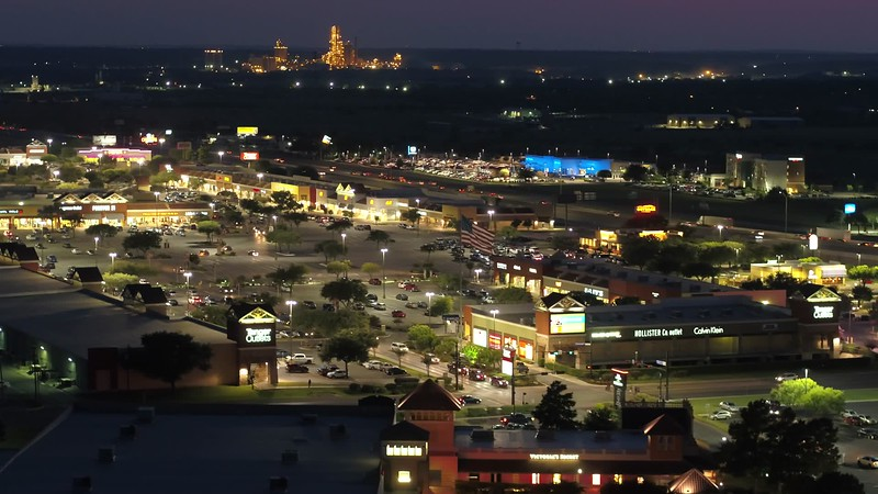 Aerial footage night Tanger Outlets San Marcos 4k
