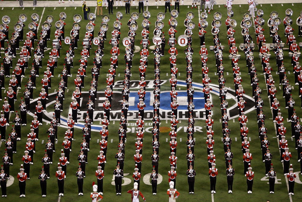 . Fans watch as bands play before the start of the Big Ten championship NCAA college football game between Ohio State and Wisconsin, Saturday, Dec. 2, 2017, in Indianapolis. (AP Photo/AJ Mast)