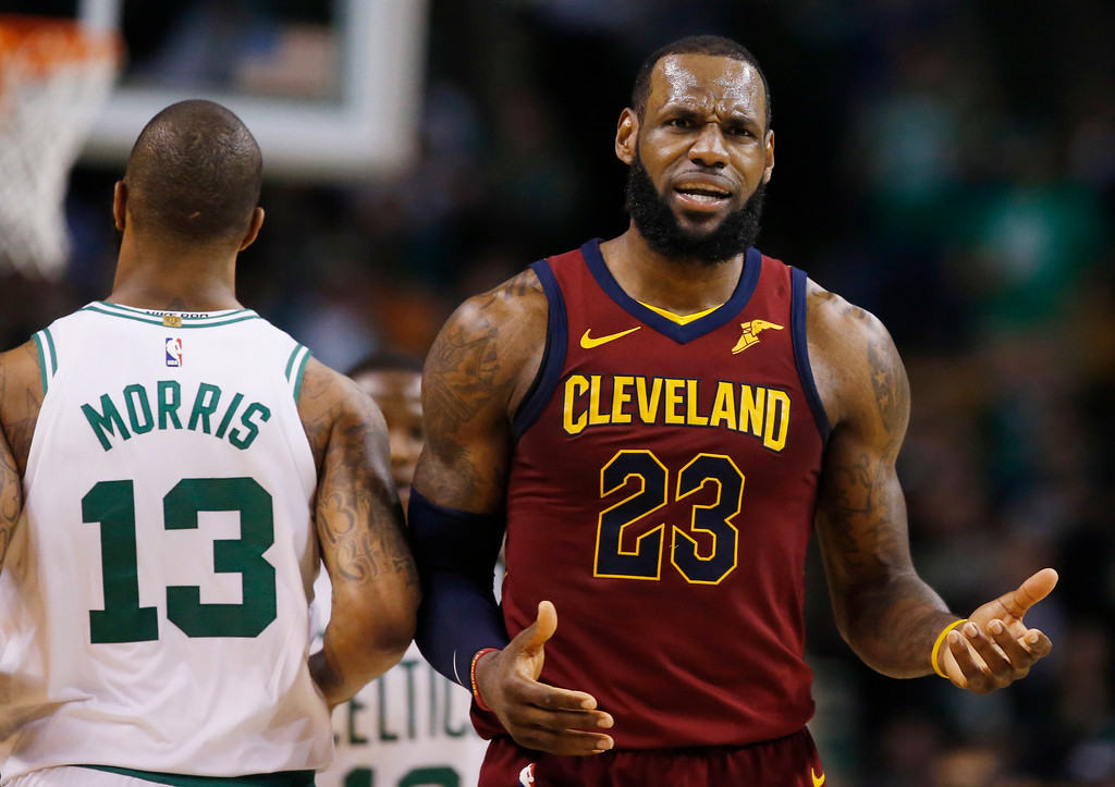. Cleveland Cavaliers forward LeBron James (23) reacts next to Boston Celtics forward Marcus Morris (13) during the third quarter of Game 1 of the NBA basketball Eastern Conference Finals, Sunday, May 13, 2018, in Boston. (AP Photo/Michael Dwyer)