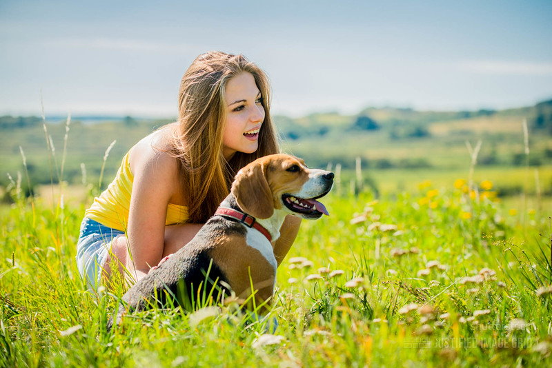 Happy young girl with Beagle