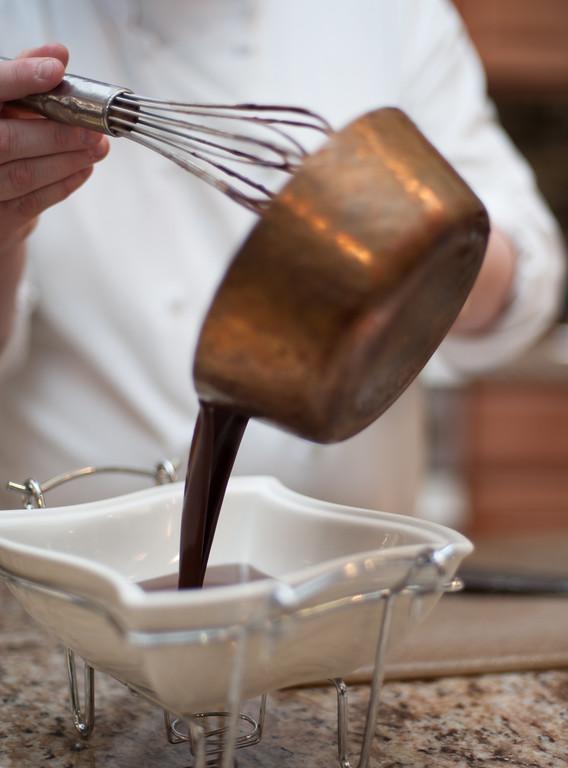 . Emma Currie pours warm chocolate fondue to a serving dish. (Sun photo by Holly Mahaffey/@hollymahaffey)