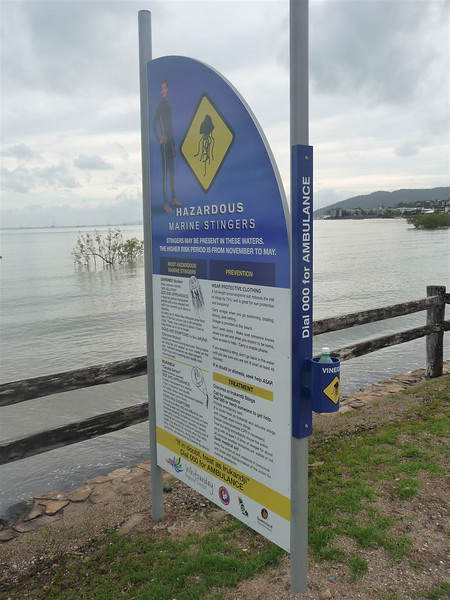 Some beaches had a very topical warning sign about poisonous stingers. Notice the readily supplied bottle of vinegar for first aid.