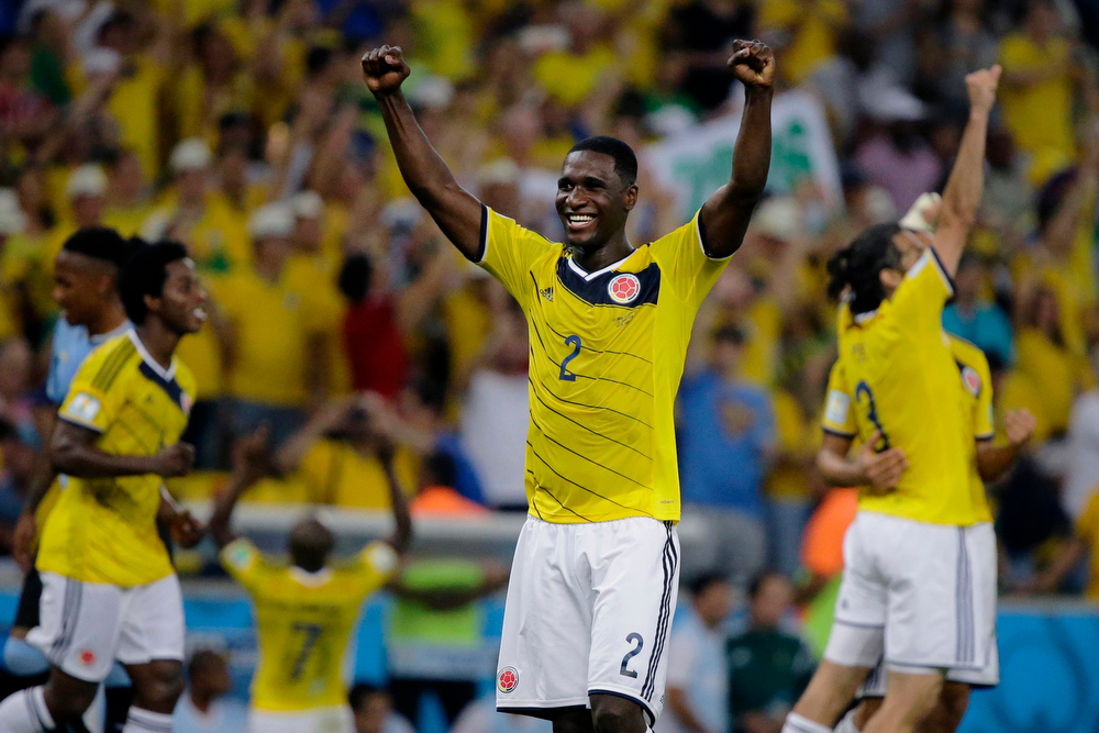 . Colombia\'s Cristian Zapata celebrates after the World Cup round of 16 soccer match between Colombia and Uruguay at the Maracana Stadium in Rio de Janeiro, Brazil, Saturday, June 28, 2014.  Colombia won the match 2-0. (AP Photo/Sergei Grits)