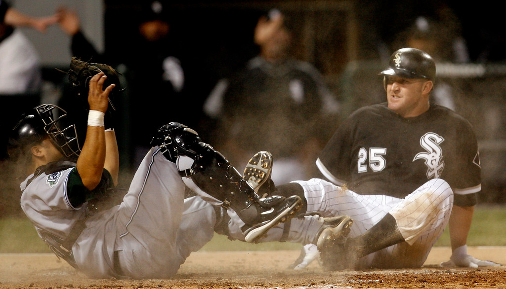 . Tampa Bay Devil Rays catcher Dioner Navarro, left, tags out Chicago White Sox\'  Jim Thome, right, at home plate during the fifth inning of a baseball game, Thursday, May 25, 2007, in Chicago.(AP Photo/Nam Y. Huh)