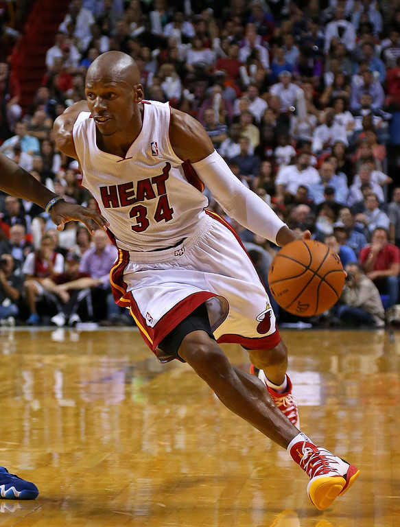 . MIAMI, FL - MARCH 14:  Ray Allen #34 of the Miami Heat dribbles during a game against the Denver Nuggets at American Airlines Arena on March 14, 2014 in Miami, Florida. (Photo by Mike Ehrmann/Getty Images)