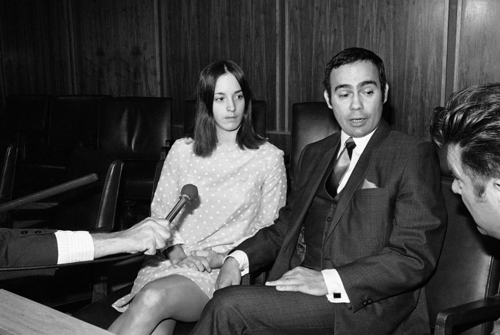 """. Richard Caballero, attorney for Susan Denise Atkins, left, tells newsmen on Dec.2, 1969 in Santa Monica, California, that his client was at the scenes of the slayings of Sharon Tate and four others at her home and of Leno and Rosemary LaBianca but that she was under a \""""hypnotic spell\"""" and had \""""nothing to do with the murders.\"""" Caballero, whose client is charged in another murder, said she was \""""hypnotized\"""" and \""""intrigued\"""" into joining a cult led by Charles Manson, 34, now in jail at Independence, California. (AP Photo/Wally Fong)"""