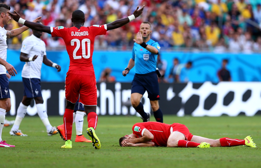 . Steve von Bergen of Switzerland lies on the pitch after a collision during the 2014 FIFA World Cup Brazil Group E match between Switzerland and France at Arena Fonte Nova on June 20, 2014 in Salvador, Brazil.  (Photo by Elsa/Getty Images)