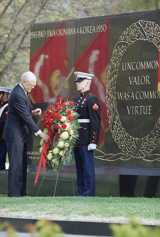 . Sen. John Glenn, D-Ohio, lays a wreath at the base of the Marine Corps War Memorial in Arlington, Va. on Wednesday, Nov. 10, 1993.   Glenn took part in the annual memorial ceremony to honor fallen Marines. (AP Photo/Joe Marquette)