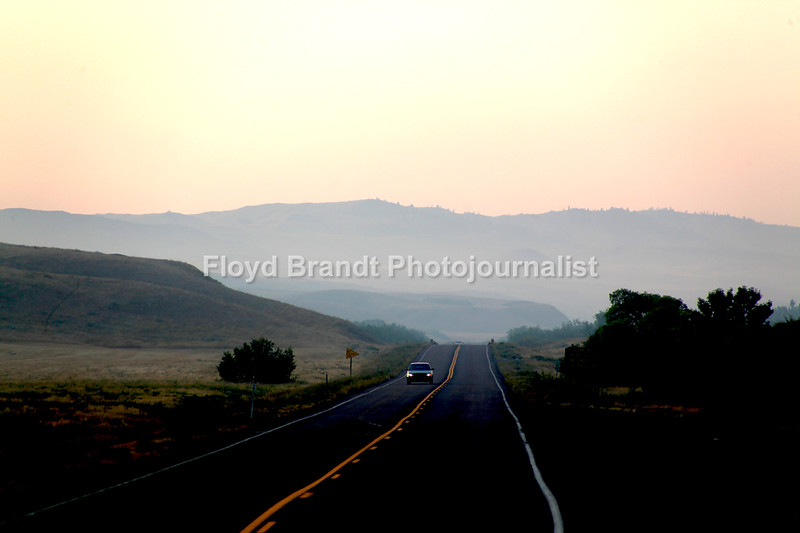 Havre Daily News/Floyd Brandt  Smoke fills the Bear Paw Mountains from the East Fork fire South of Havre Beaver Creek Reservoir in the early morning Tuesday