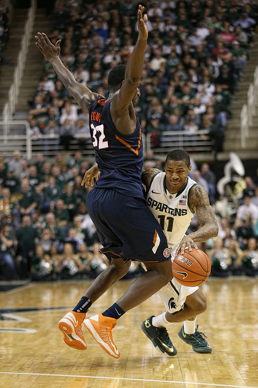 . Keith Appling #11 of the Michigan State Spartans drives the ball around Nnanna Egwu #32 of the University of Illinois at the Breslin Center on March 1, 2014 in East Lansing, Michigan. Illinois defeated Michigan State 53-46. (Photo by Leon Halip/Getty Images)