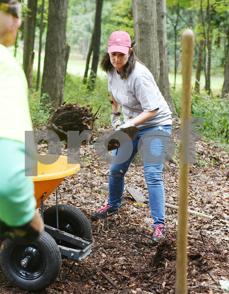 Harold Aughton/Butler Eagle: Julie Diamond, product information analyst at AK Steel, participated in the company's Day of Caring activity at Preston Park.