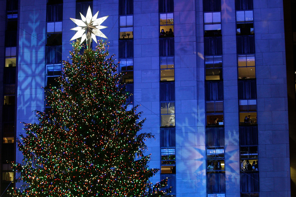 . The Rockefeller Center Christmas Tree stands lit in front of the General Electric building in New York\'s Rockefeller Plaza during the 77th annual tree lighting ceremony Wednesday, Dec. 2, 2009  in New York. (AP Photo/Frank Franklin II)