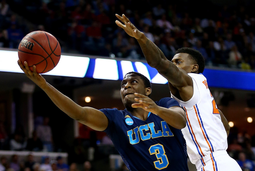 . Jordan Adams #3 of the UCLA Bruins goes to the basket as Casey Prather #24 of the Florida Gators defends during a regional semifinal of the 2014 NCAA Men\'s Basketball Tournament at the FedExForum on March 27, 2014 in Memphis, Tennessee.  (Photo by Streeter Lecka/Getty Images)