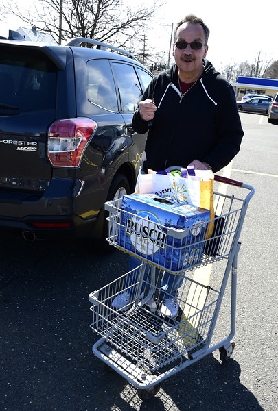 3/21/2020 Mike Orazzi | Staff Mike Korbabicz's has beer and steak in his cart after shopping at Gnazzo's in Plainville on Saturday.