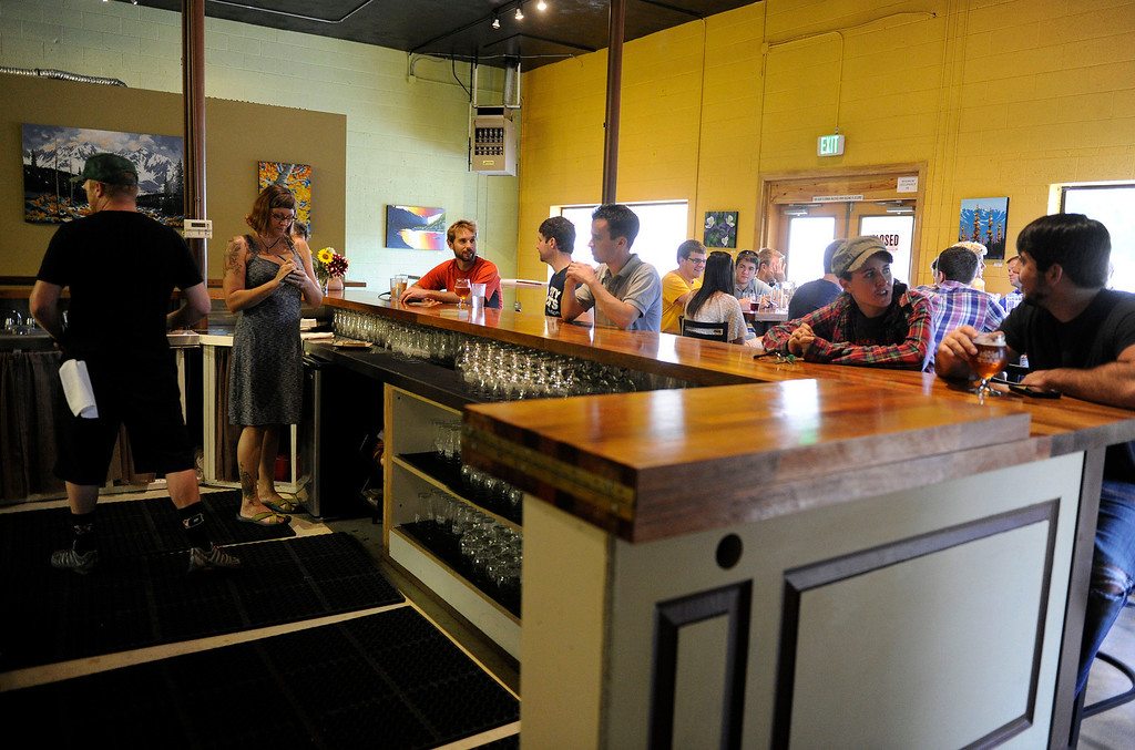 . GOLDEN, CO - AUGUST 23: Customers enjoy the Mountain Toad Brewing beer selection on August 23, 2013, in Golden, Colorado. (Photo by Anya Semenoff/YourHub)