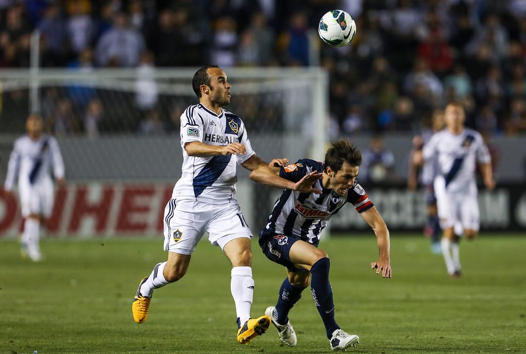 . Los Angeles Galaxy midfielder Landon Donovan, left, and Monterrey defender Jose Maria Basanta during the CONCACAF Champions League semifinal, Wednesday, April 3, 2013, in Carson, Calif. Monterrey won 2-1. (AP Photo/Bret Hartman)