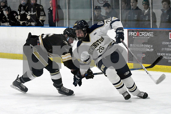 12/30/2017 Mike Orazzi | Staff Newington's Ethan Ranger (26) and Joel Barlow's Andrew Powell (16) at the Newington Ice Arena Saturday.
