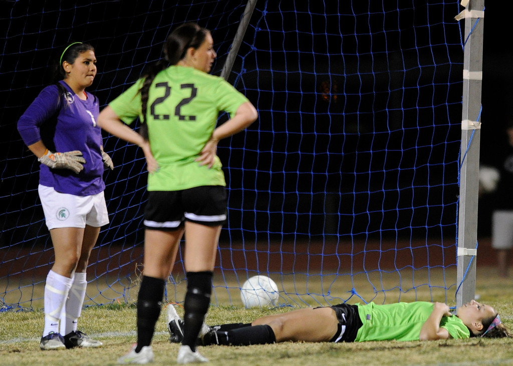 . South Torrance #1 Kylie Christian, #22 Morgan Mullin and #12 Charlie Tavormina are dejected after the sudden death loss. The Girls from Quartz Hill defeated South Torrance in a sudden death overtime in a Southern Section Division IV Semifinal soccer game. Quartz Hills, CA 2/23/2013(John McCoy/Staff Photographer)