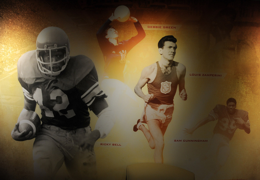. Athletes from various decades appear on the wall leading into the administrative offices. Heritage Hall, which houses USC\'s athletic department, has been closed for the past year while undergoing a $35-million renovation.  The building first opened in 1971 at a cost of $2.8 million and was originally 48,000 square feet. It now is 80,000 square feet. As part of the renovation, Heritage Hall\'s two-story lobby has been transformed into a state-of-the-art museum space featuring interactive displays. Heritage Hall also includes a sports performance center, a broadcast studio, a lounge for Women of Troy student-athletes, a rowing ergometer room and an indoor golf driving area, plus new locker rooms, meeting rooms, equipment room and event space.   Los Angeles , CA. January 30, 2014 (Photo by John McCoy / Los Angeles Daily News)