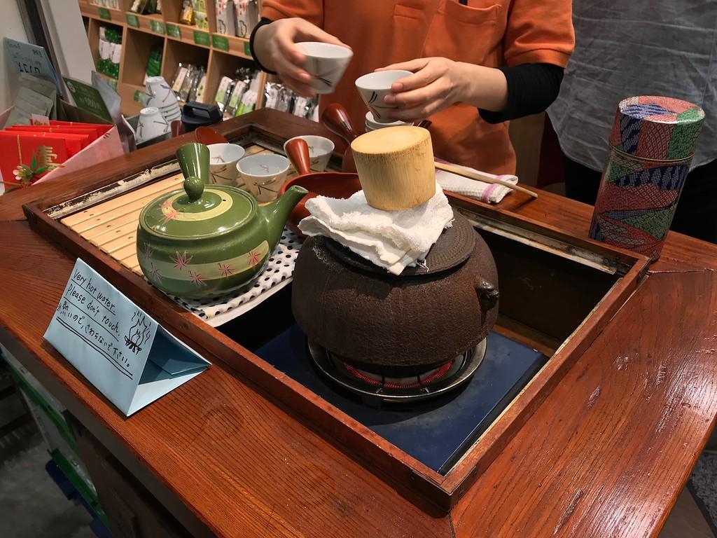 Sampling tea at the market.