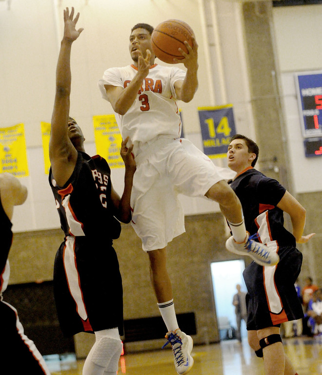 . 03-12-2013--(LANG Staff Photo by Sean Hiller)-Serra\'s 	Roland Wyatt (3) goes to the basket against Pacific Hills\' Namon Wright (12) in Tuesday\'s boys basketball IV Southern California Regional semifinal at L.A. Southwest College.