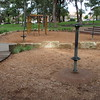 spinners in softfall mulch and climbing frame with rope nets and ladder