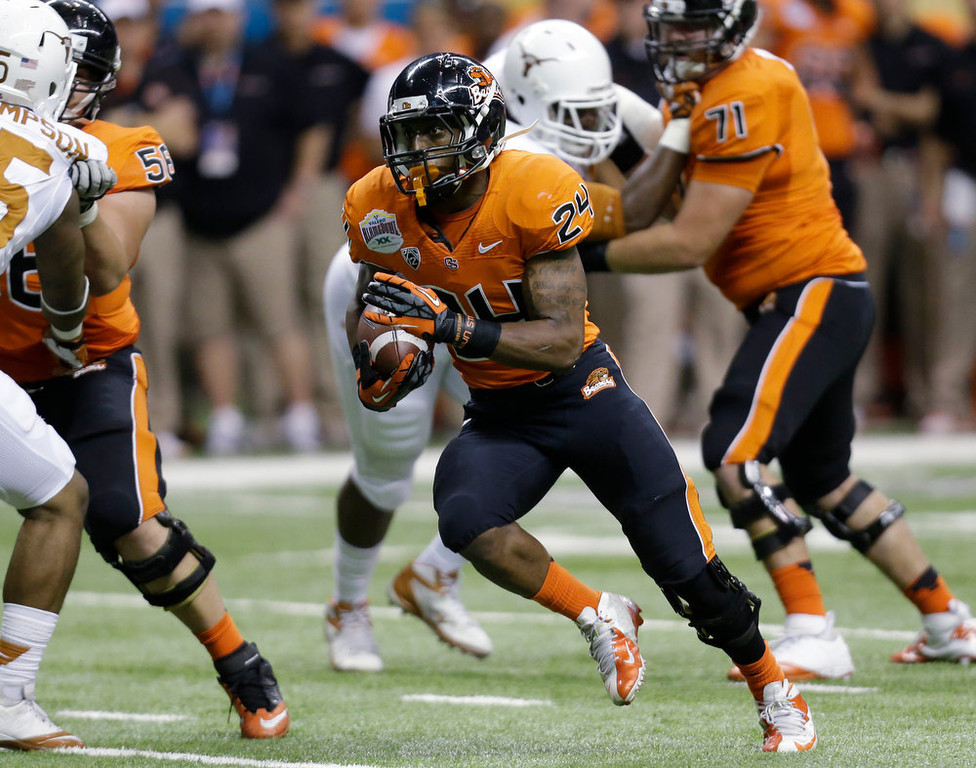 . Oregon State\'s Storm Woods (24) rushes for a touchdown against Texas during the first quarter of the Alamo Bowl NCAA football game, Saturday, Dec. 29, 2012, in San Antonio.  (AP Photo/Eric Gay)