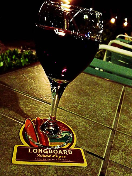 molokai hotel glass of red.jpg