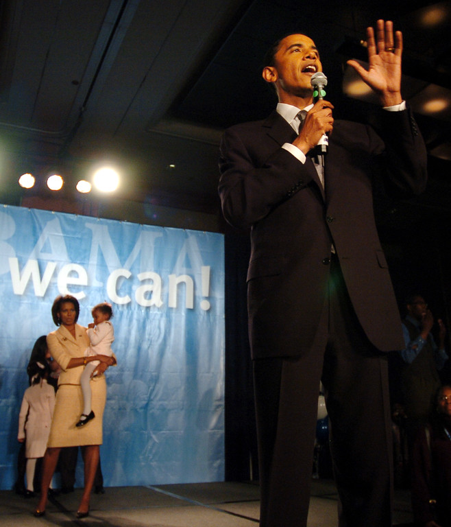 . Illinois U.S. Senator-elect Barack Obama, with his wife Michelle looking on with their youngest daughter, Sasha, 3, gives his acceptance speech in Chicago, Tuesday, Nov. 2,  2004.  Obama, only the fifth black U.S. Senator to be elected in history, defeated Republican Alan Keyes in the nation\'s first Senate race with two black major-party candidates.  (AP Photo/Jeff Roberson)