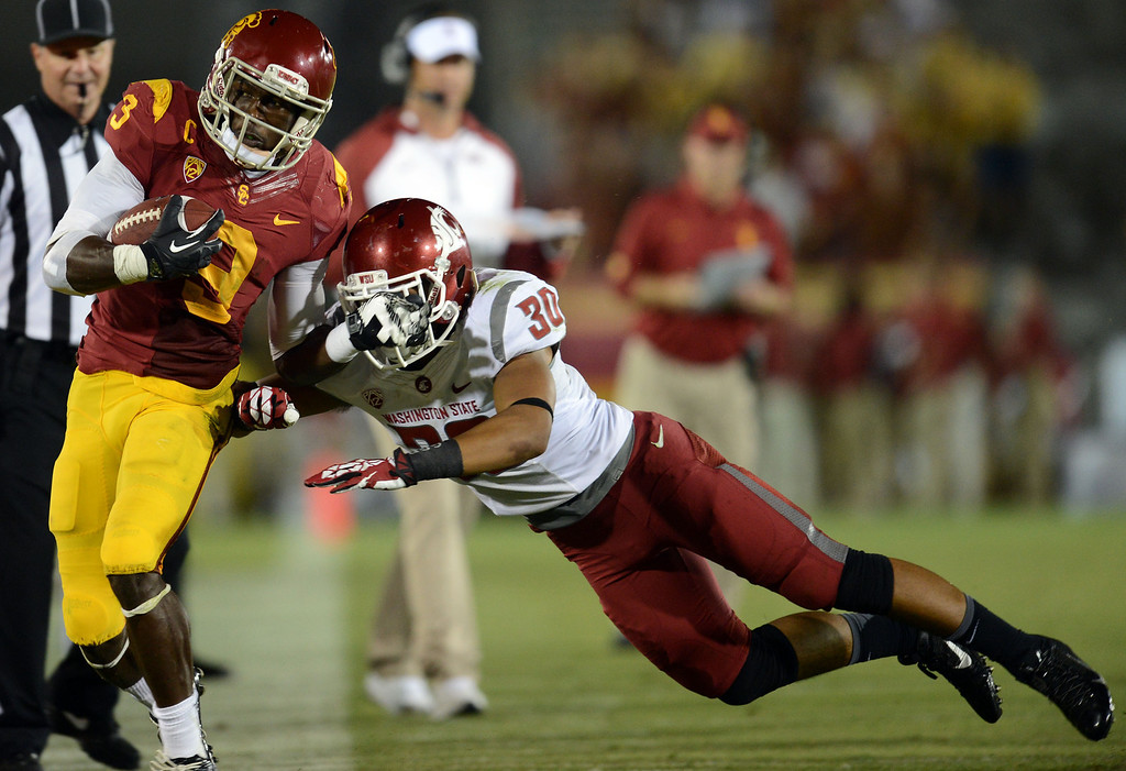 . USC\'s Marqise Lee #9 gets knocked out of bounds by Washington State\'s Taylor Taliulu #30 during their game at the Los Angeles Memorial Coliseum  Saturday, September 7, 2013. Washington State beat USC10-7. (Photo by Hans Gutknecht/Los Angeles Daily News)