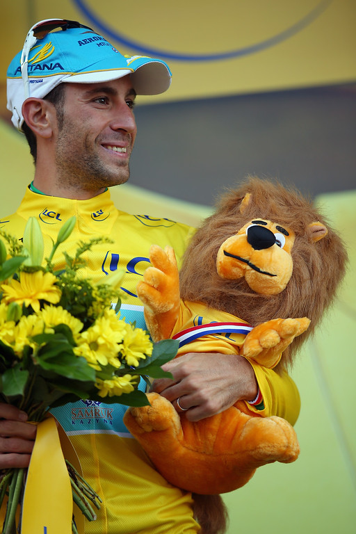 . Vincenzo Nibali of Italy and the Astana Pro Team stands on the podium after winning the stage and regaining the overall race leader\'s yellow jersey during stage ten of the 2014 Tour de France, a 162km stage between Mulhouse and La Planche des Belles Filles, on July 14, 2014 in La Planche des Belles, France.  (Photo by Bryn Lennon/Getty Images)