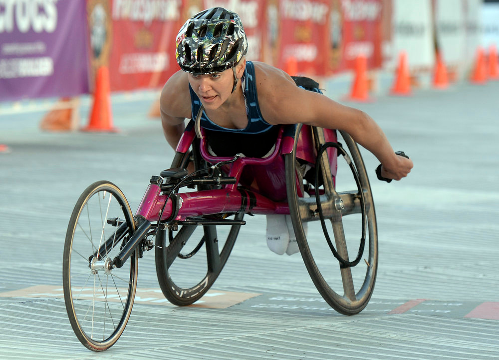 . Women\'s Professional Wheelchair racer Susannah Scaroni crosses the finish line in first place for the women\'s wheelchair race during the Bolder Boulder on Monday, May 27, in Boulder.  Jeremy Papasso/ Camera