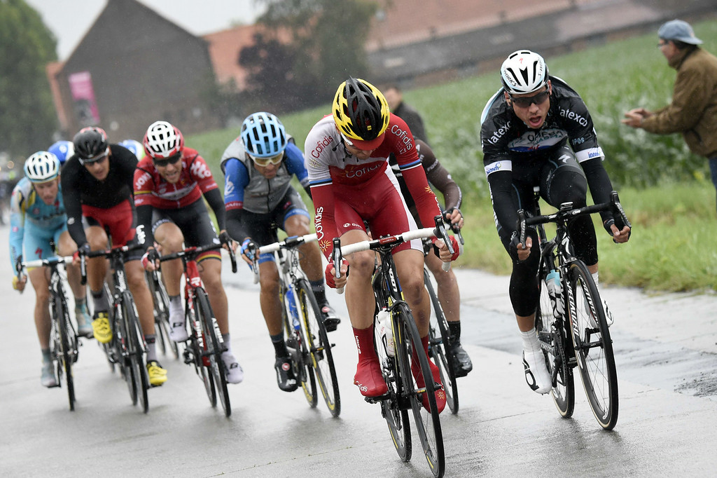 . (From R) Germany\'s Tony Martin, France\'s Samuel Dumoulin (hidden), France\'s Cyril Lemoine, Colombia\'s Janier Alexis Acevedo Colle, France\'s Tony Gallopin, Germany\'s Marcus Burghardt and Netherlands\' Lieuwe Westra ride in a breakaway during the 155 km fifth stage of the 101st edition of the Tour de France cycling race on July 9, 2014 between Ypres, northwestern Belgium, and Arenberg Porte du Hainaut in Wallers northern France.  AFP PHOTO / ERIC FEFERBERG/AFP/Getty Images