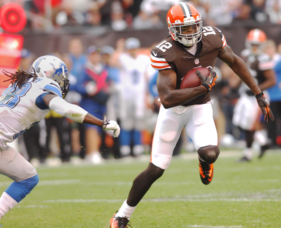 . Michael Allen Blair/MBlair@21st-CenturyMedia.com The Browns\' Josh Gordon runs up field for a first down after the catch in front of the Lions\' Bill Bentley during the second quarter versus the Lions at FirstEnergy Stadium in Cleveland, OH. on Sunday, October 13, 2013.