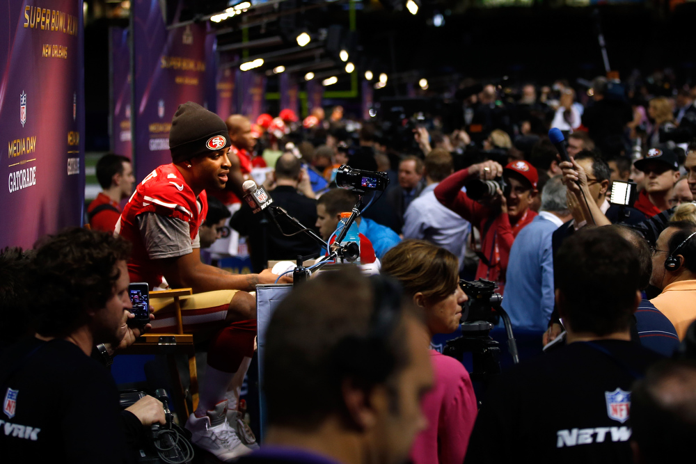 Description of . Michael Crabtree #15 of the San Francisco 49ers answers questions from the media during Super Bowl XLVII Media Day ahead of Super Bowl XLVII at the Mercedes-Benz Superdome on January 29, 2013 in New Orleans, Louisiana. The San Francisco 49ers will take on the Baltimore Ravens on February 3, 2013 at the Mercedes-Benz Superdome.  (Photo by Chris Graythen/Getty Images)