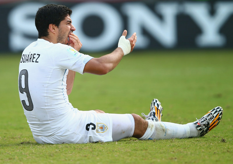. Luis Suarez of Uruguay reacts after a clash during the 2014 FIFA World Cup Brazil Group D match between Italy and Uruguay at Estadio das Dunas on June 24, 2014 in Natal, Brazil.  (Photo by Clive Rose/Getty Images)
