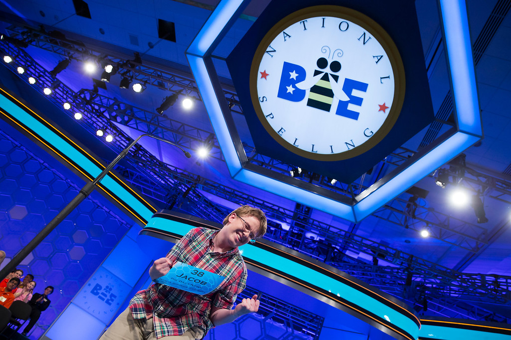 ". Jacob Williamson, 15, of Cape Coral, Fla., celebrates after spelling ""carcharodont\"" correctly during the final round of the National Spelling Bee, on Thursday, May 29, 2014, in Oxon Hill, Md. (AP Photo/ Evan Vucci)"