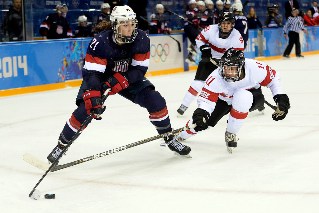 . Hilary Knight (21) of the U.S.A. looks for a shot as Angela Frautschi (11) of the Switzerland defends during the second period of action at the Shayba Arena. Sochi 2014 Winter Olympics on Monday, February 10, 2014. (Photo by AAron Ontiveroz/The Denver Post)