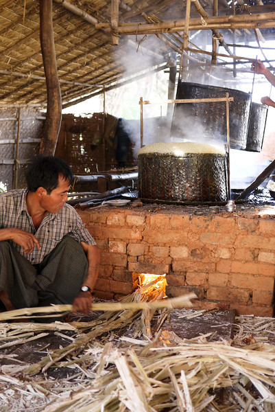 Boiling vats of sugarcane juice are almost finished and ready to be made into jaggery candies near Nyaung Shwe, on Inle Lake, Burma (Myanmar).