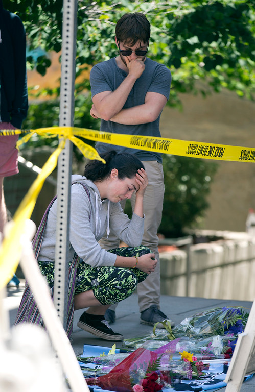 . Unidentified mourners console each other at the scene of a balcony collapse at an apartment building on Kittredge Street in Berkeley, Calif., Tuesday, June 16, 2015. Six people were killed and seven others were taken to area hospitals. (D. Ross Cameron/Bay Area News Group)