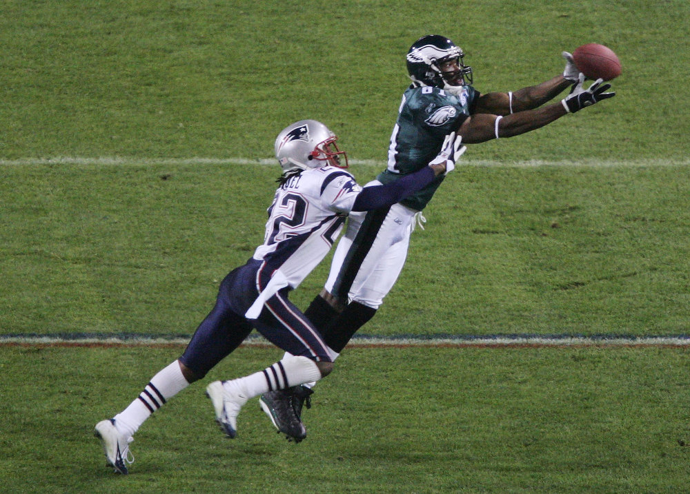 Description of . Wide receiver Terrell Owens #81 of the Philadelphia Eagles catches a 10-yard pass against Asante Samuel #22 of the New England Patriots during the fourth quarter of Super Bowl XXXIX at Alltel Stadium on February 6, 2005 in Jacksonville, Florida.  (Photo by Al Bello/Getty Images)