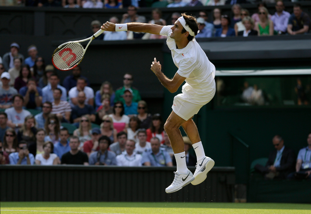 . Roger Federer of Switzerland serves to Sergiy Stakhovsky of Ukraine during their Men\'s second round singles match at the All England Lawn Tennis Championships in Wimbledon, London, Wednesday, June 26, 2013. (AP Photo/Alastair Grant)