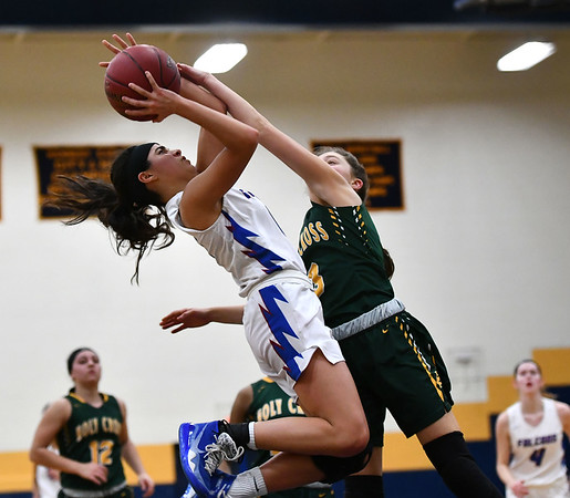2/26/2020 Mike Orazzi | StaffrSt. Paul Catholic High School's Janessa Gonzalez (11) and Holy Cross' Ella Atkins (3) during Wednesday night's CCC girls basketball tournament at Kennedy High School in Waterbury. rr