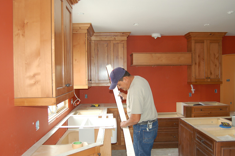 Laying out the granite countertops is an exacting job.